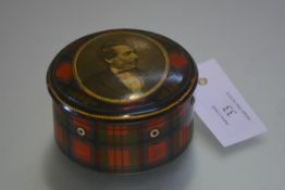 A late 19th century Tartanware cotton reel box, of cylindrical form, the cover printed with an image