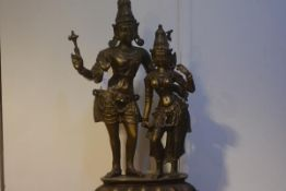 A large Indian bronze group of two deities, one Vishnu, on a stepped integral stand. Height 93cm
