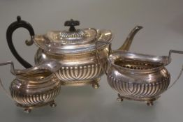 A late Victorian silver three piece tea service, Thomas Bradbury & Sons, London 1894, in the Regency