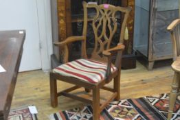 An oak child's armchair in the Chippendale taste, c. 1900, with yoke crest rail and pierced splat,