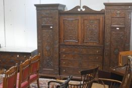 An Edwardian mahogany partial bedroom suite, in the Adam Revival taste, comprising: a compactum