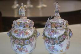 A pair of striking German porcelain jars and covers, late 19th century, each decorated with floral