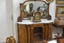 A mid-Victorian inlaid walnut, marble-topped, mirror-backed credenza, the arched mirror plate