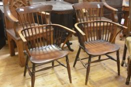 A pair of elm and yew comb back Windsor armchairs, 19th century, the dished seats between bowed