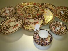 A group of Royal Crown Derby Imari wares comprising: in pattern 2451, four saucers, four side