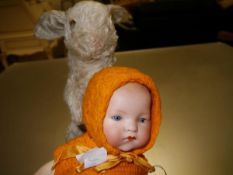 An Armand Marseille bisque socket head doll with open and shut blue eyes, on a ball-jointed