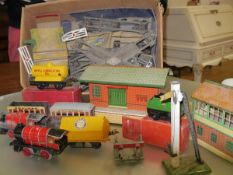 A box of 0 gauge Hornby including an oil tanker (boxed), assorted track, buildings and rolling