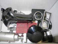 A box containing a mixed lot including Hasselblad pistol grip, Leitz mount, Paillard Bolex filter
