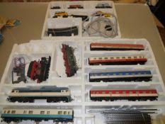 A Piko boxed German passenger train set; plus a small freight set boxed