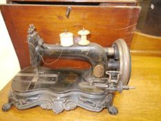 A late 19thc German cast iron sewing machine, Junker & Ruh, the base moulded with rococo scrolls