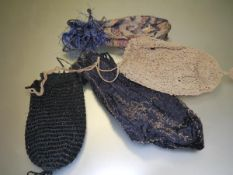 A group of four early 20th century lady's evening pouch bags, two decorated with beadwork. (4)