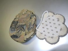A French 1920's embroidered evening bag with faux ivory clasp and chain; together with a faux