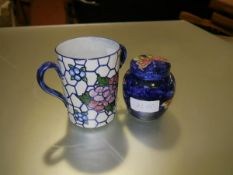 A pottery twin-handled cup, c. 1920, painted with floral sprays, signed J. W. Wilson to the base;