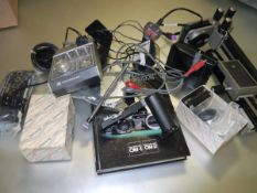 A collection of items for an Olympus OM system to include bellows, motor drive etc