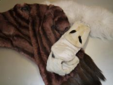 A vintage mink stole with tail tassels; together with a small ermine stole; and a white fur stole (