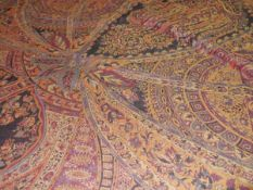 A large printed woollen shawl of Paisley type. c. 260cm by 240cm