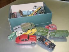 A mixed lot of Dinky playworn die-cast cars including military and commercial vehicles