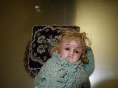 A poured wax, over composition, shoulder plate doll, c. 1900, with brown glass eyes, blonde wig,