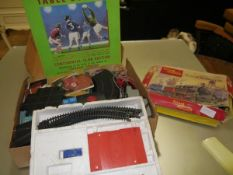 A mixed lot including a Minic racing set with cars and track, a Tri-ang clockwork dockmaster set and