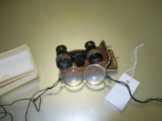 A pair of Eldis opera glasses in leather case, together with two late 19thc gilt metal monocles (a