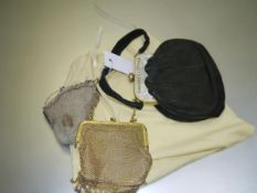 A gilt mesh lady's evening purse, early 20th century; together with a white metal mesh purse; and