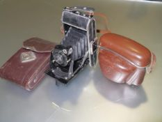 A mid-century Voigtlander Bessa folding camera in brown leather case, Voigtar Anastgmat lens 1:7.7