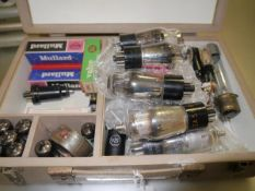 A box containing a collection of vintage thermionic valves