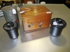 A collection of vintage film tanks to include a Kodak tank, Paterson and Paterson Universal