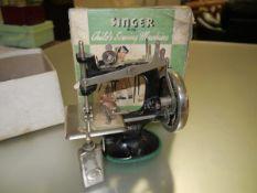 A child's Singer No. 20 sewing machine in original box