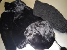A black beaver evening jacket; a black beaver muff; and a black astrakan shawl (3)