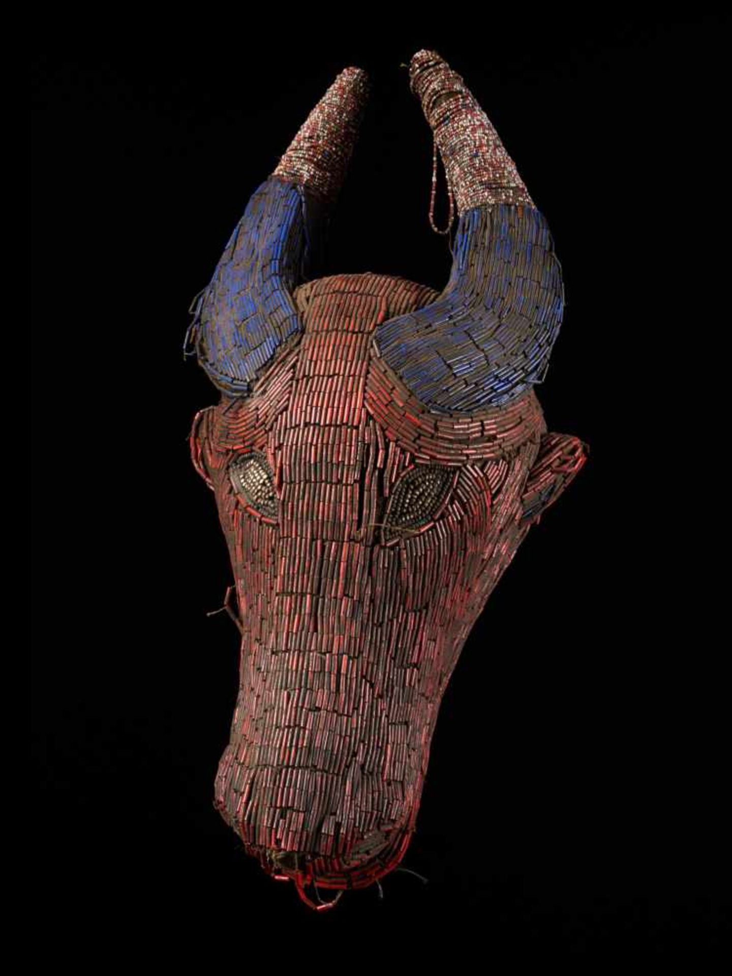 Beaded Red And Blue Buffalo Mask - Tribal ArtA gorgeous red buffalo mask. The wooden mask is beset