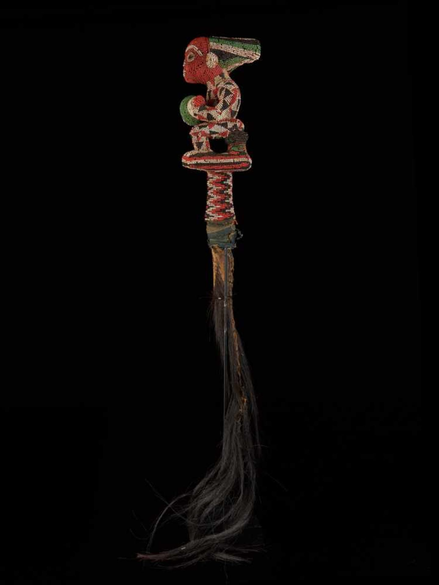 Beaded Flywhisk-Sitting Royal Figure - Tribal ArtA beautiful beaded flywhisk. The handle is