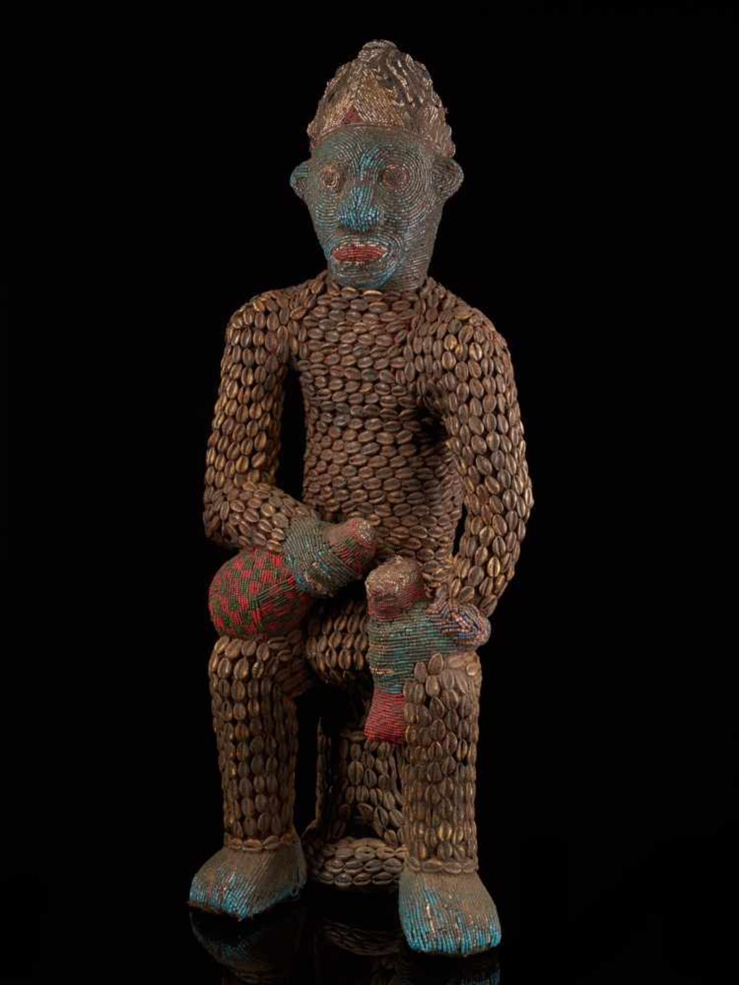 Beaded Royal Figure Holding Wine Vessel - Tribal ArtThis exquisite beaded figure of a man holding