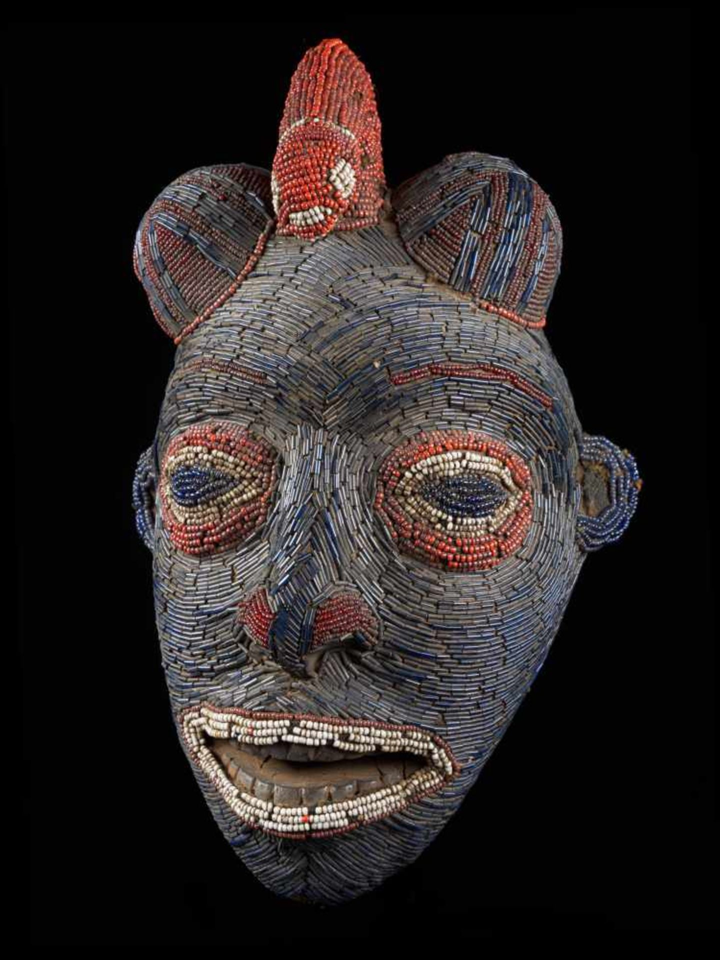 Facemask Topped With Leopard Figure - Tribal ArtAn exquisite blue face mask. This wooden mask is