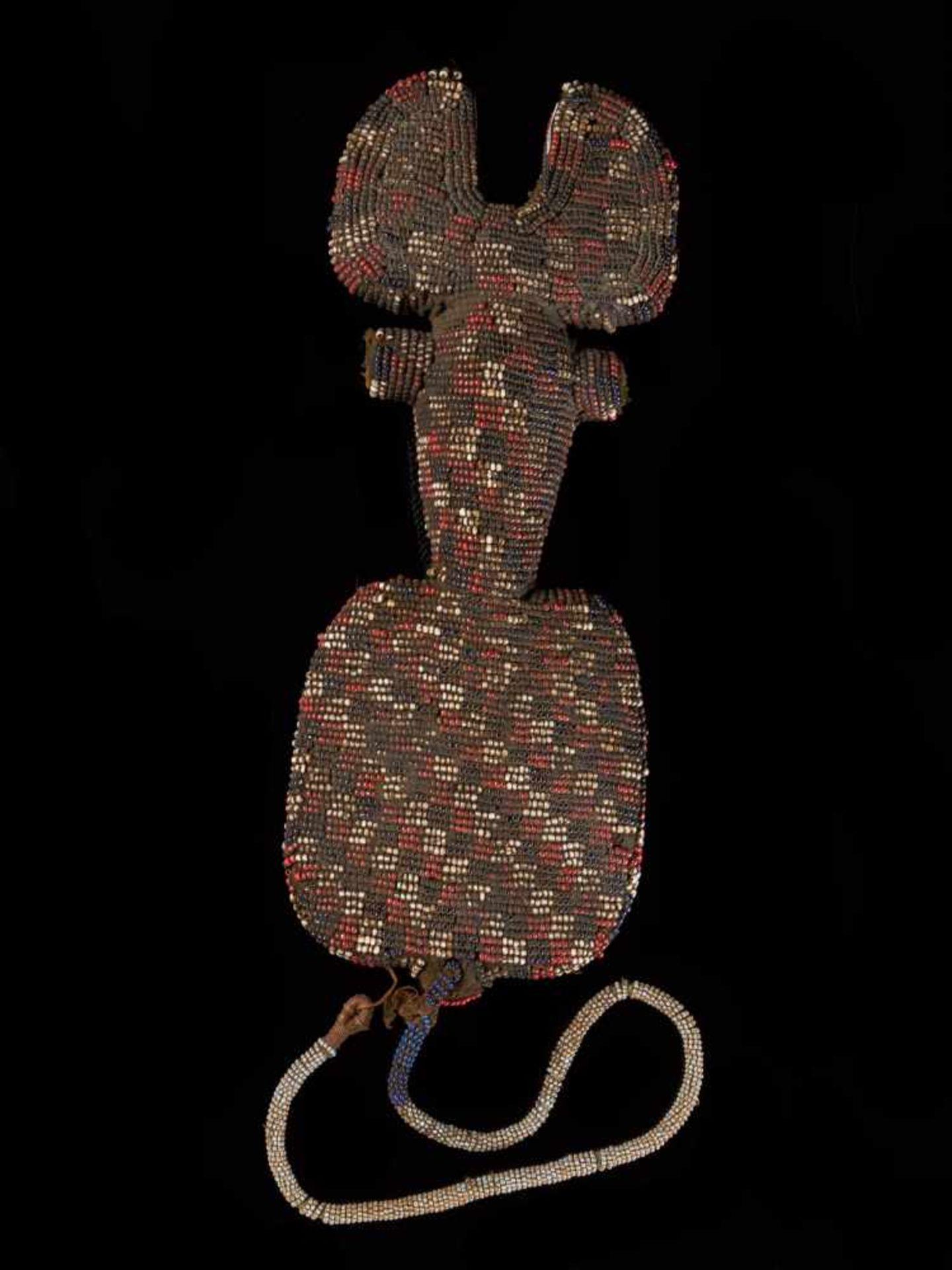 Beaded Ceremonial Flute - Tribal ArtThis intriguing beaded ceremonial flute is covered with a