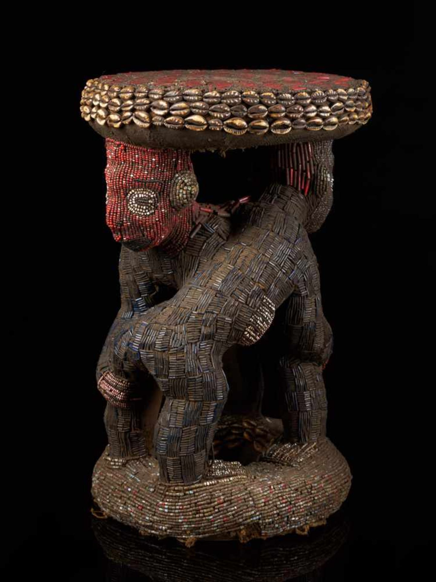 Beaded Royal Stool Supported By Two Figures - Tribal ArtThis exquisite stool has a round base and