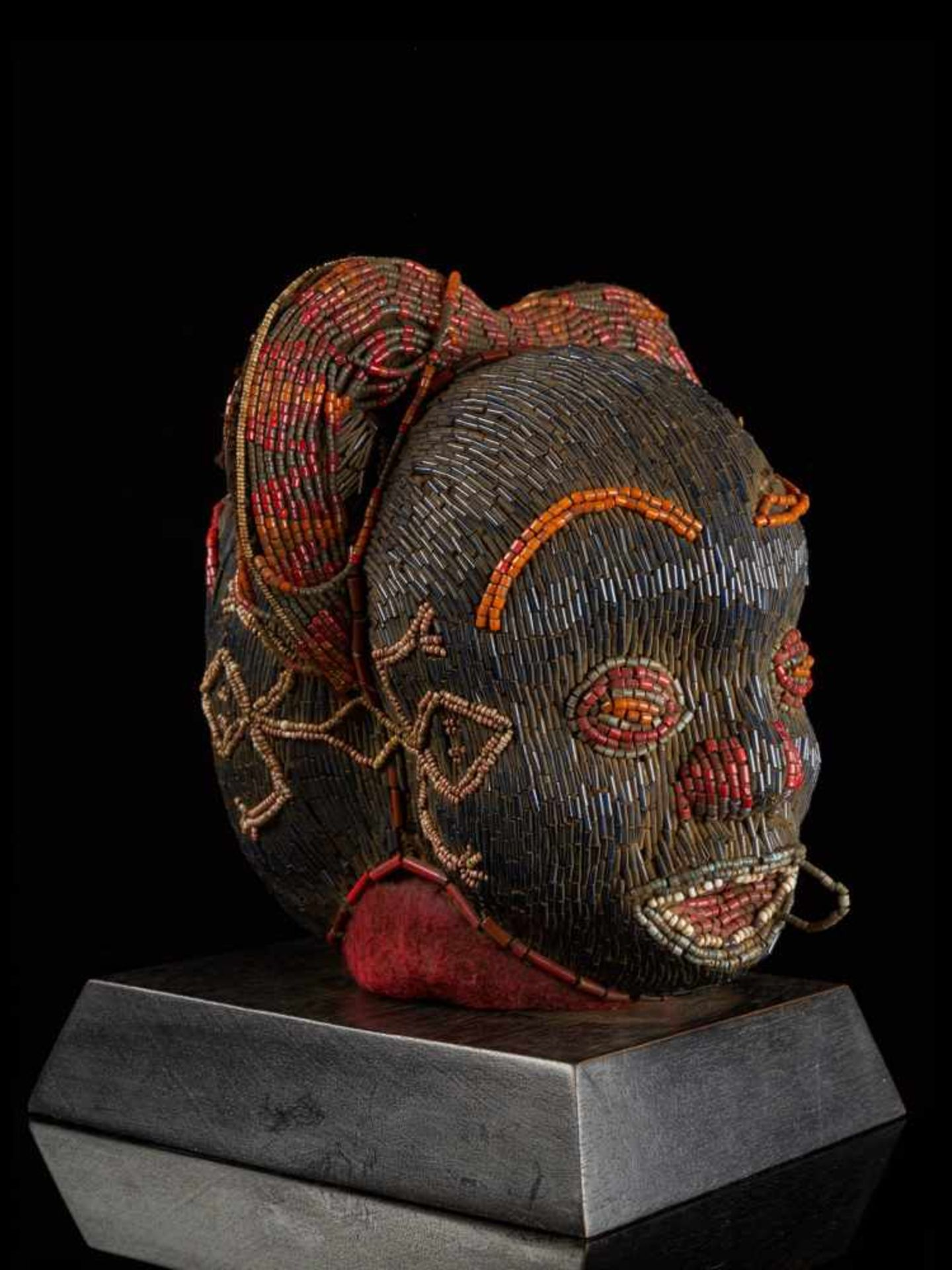 Beaded Janus Head Sculpture With Headdress - Tribal ArtThis beautiful two-faced head sculpture is