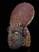 Beaded Red And Blue Helmet Mask And Kauris Decorated Back - Tribal ArtThis striking piece is