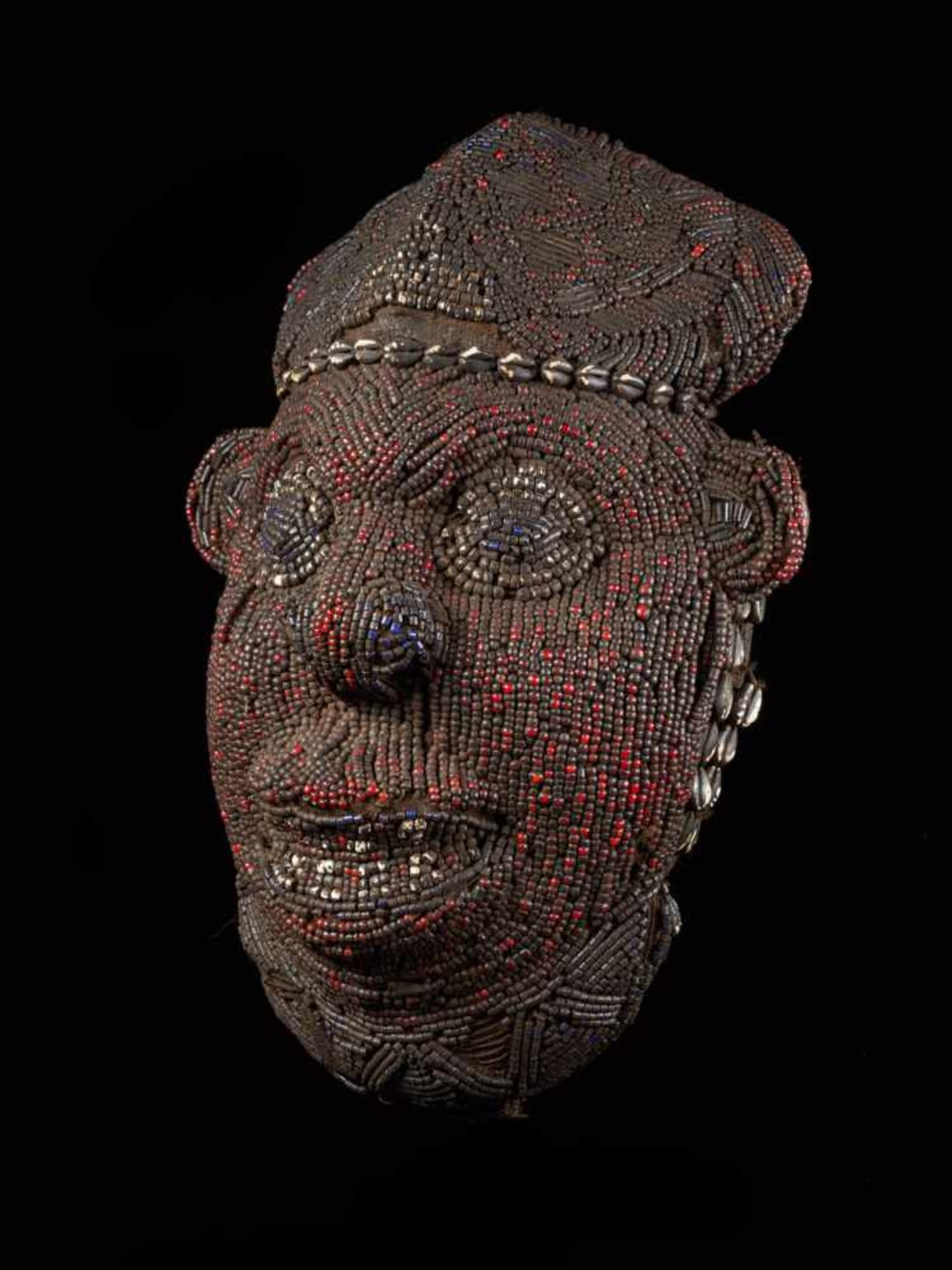 Beaded Red Head Mask - Tribal ArtThis exquisitely characterful face is beset with small red glass