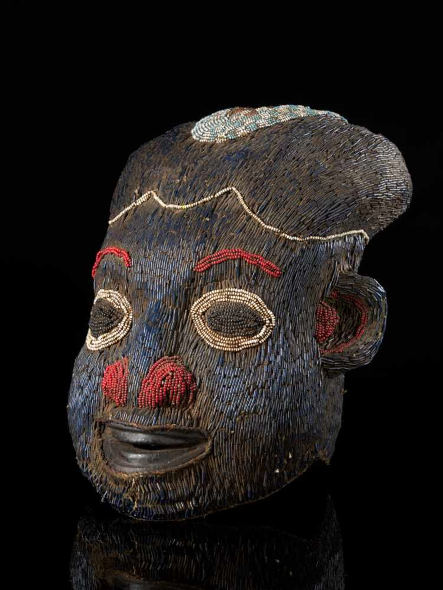 Beaded Helmet Mask Blue-Wooden Mouth - Tribal ArtThis characterful beaded blue mask has been