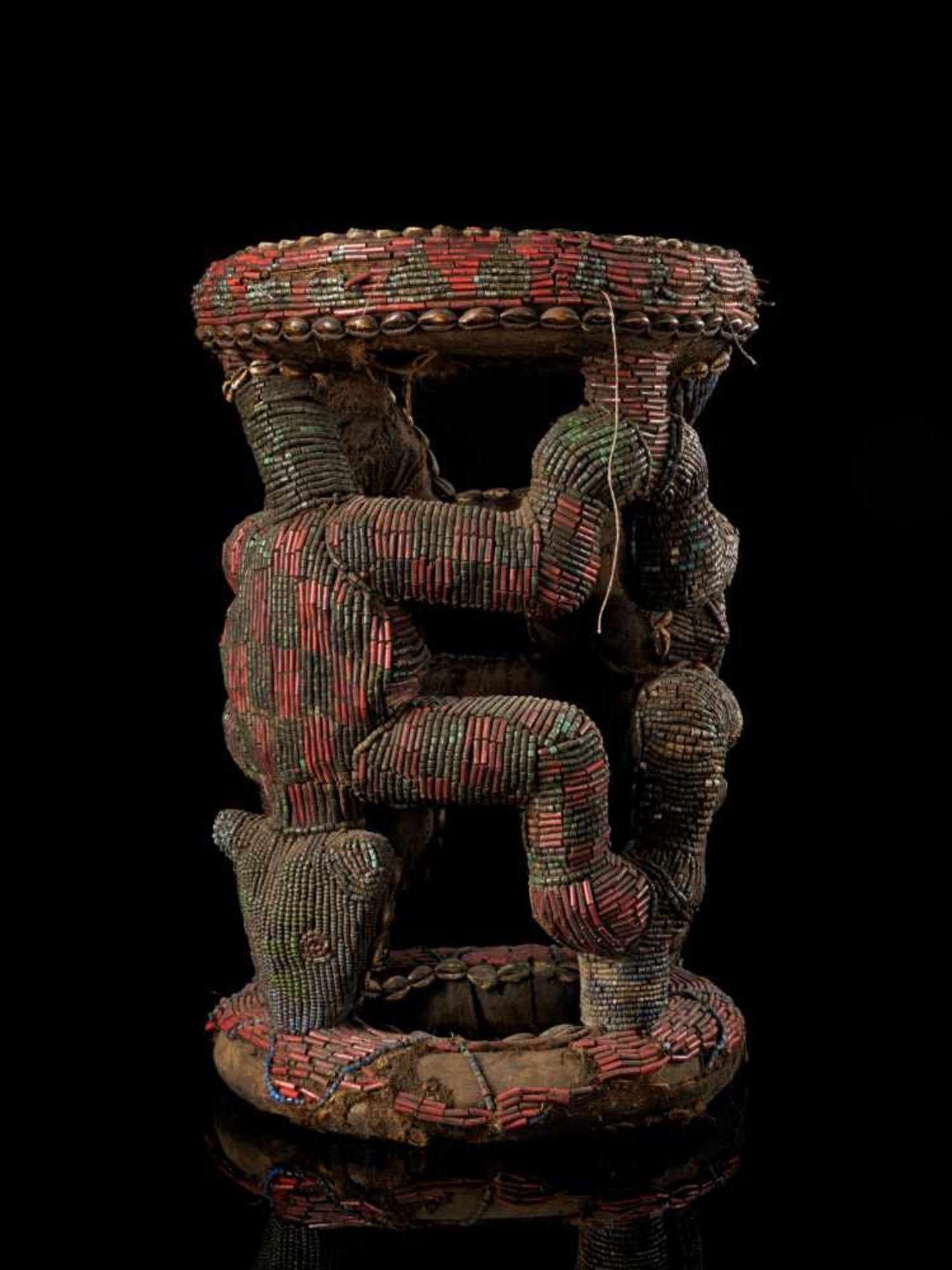 Beaded Royal Stool Supported By Two Leopards - Tribal ArtThis stunning stool has a round base and