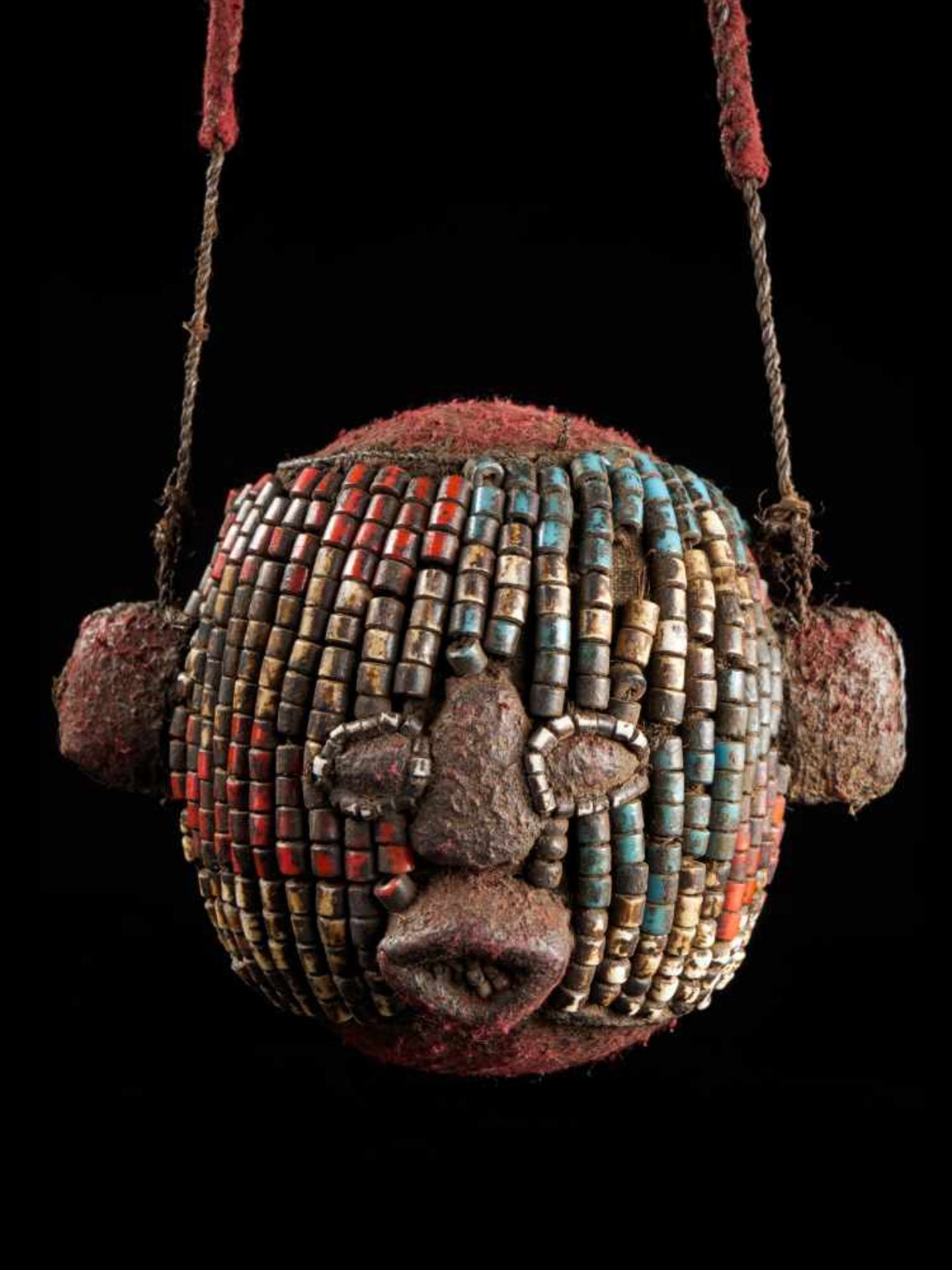 Beaded Ceremonial Trophy Head - Tribal ArtFashioned from wood, cloth and red, white and blue glass