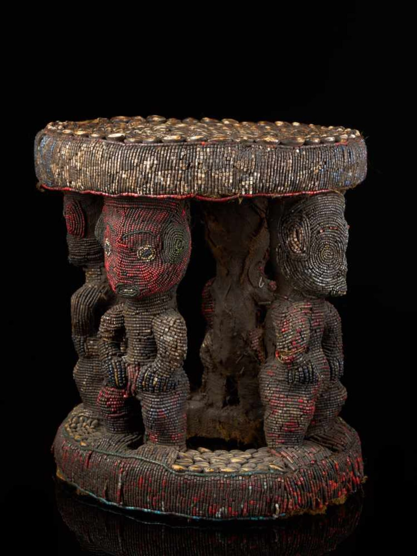 Beaded Royal Stool Supported By Four Figures - Tribal ArtThis stunning stool has a round base and