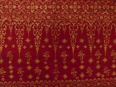 GebetstuchOman, wohl 19. Jh.Rechteckform mit floraler Goldmalerei auf rotem Grund. 85 x 198 cm. -