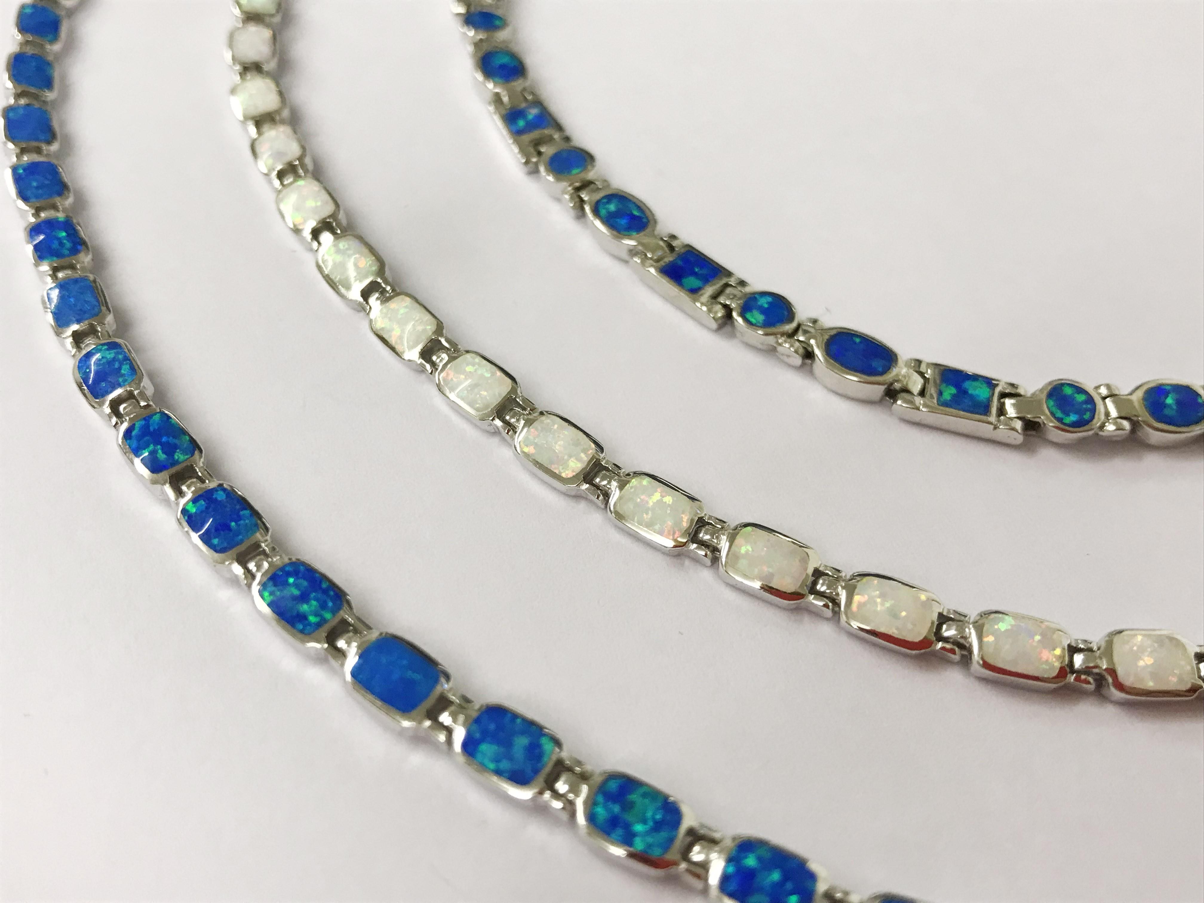 Lot 36 - X3 sterling silver opal bracelets