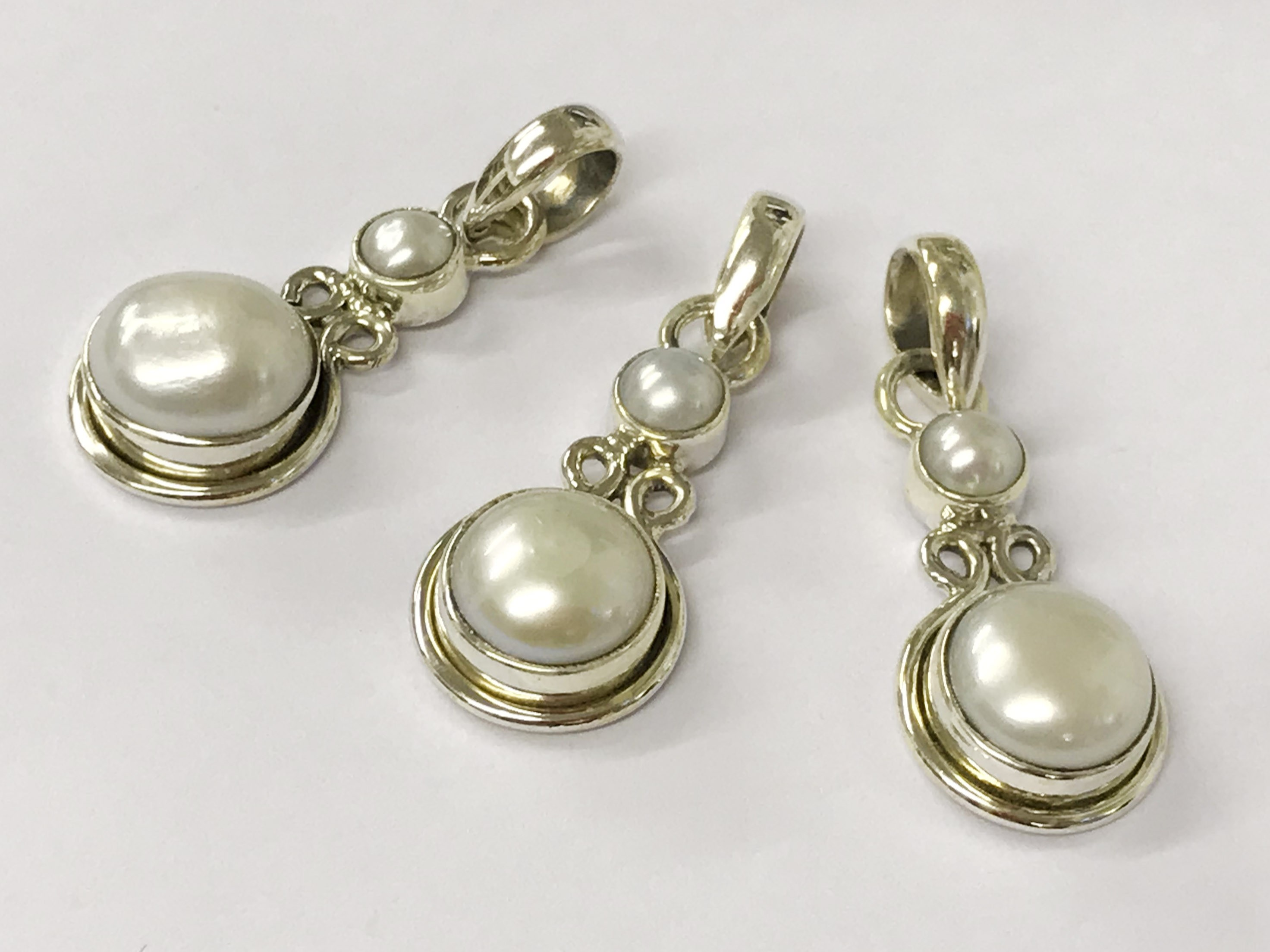 Lot 34 - X3 sterling silver south sea pearl pendants