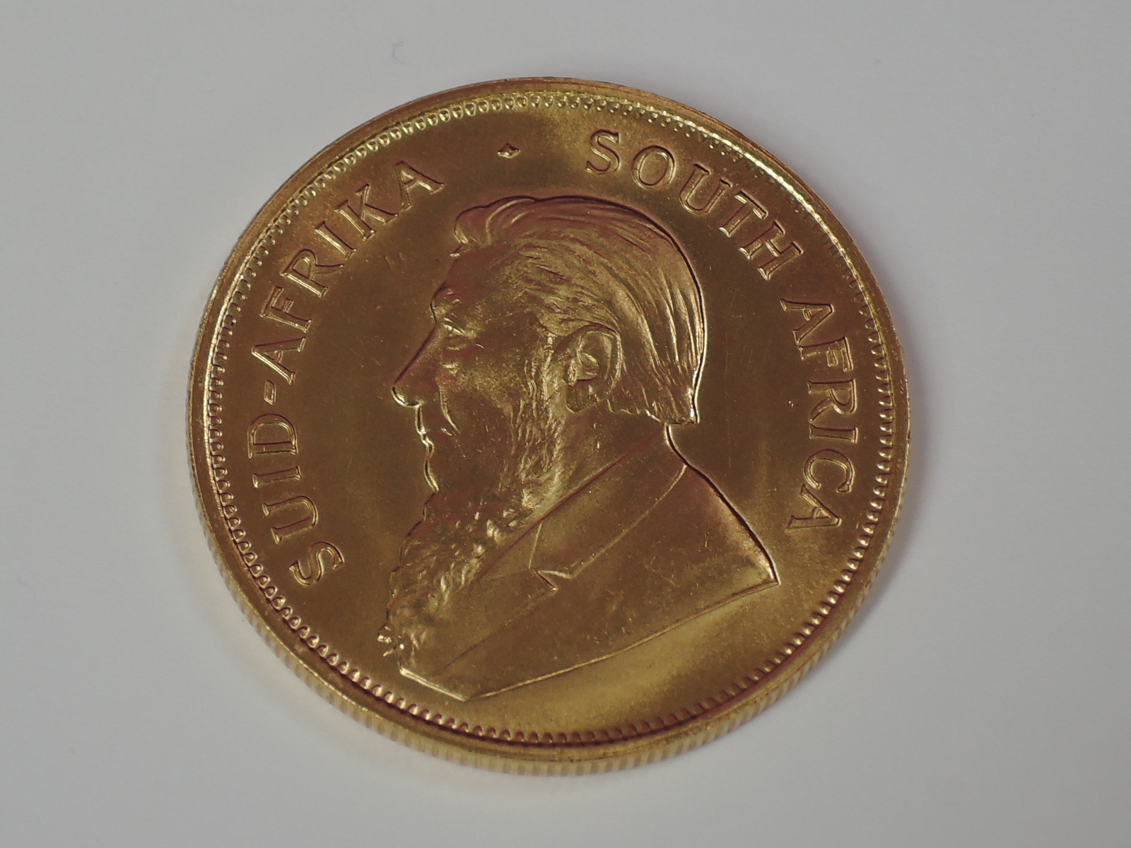 Lot 622 - A gold 1oz 1978 South African Krugerrand coin, in plastic case