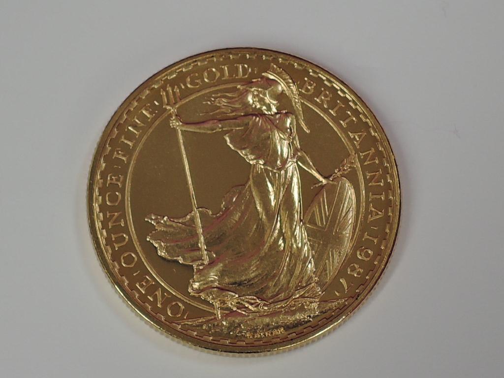 Lot 630 - A gold 1oz 1987 Great Britain Britannia 100 pound coin, in plastic case