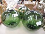 Lot 46 - A selection of vintage green glass fishing floats