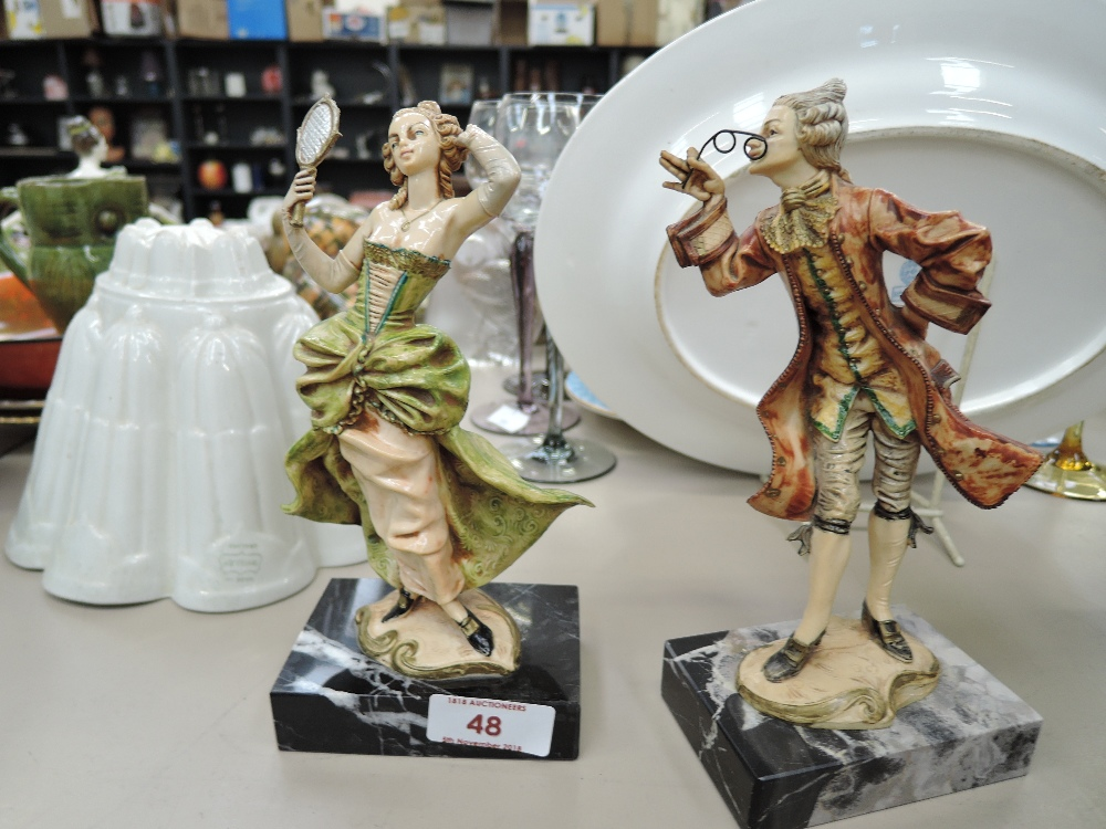 Lot 48 - A pair of Carrara Marble figures in period dress